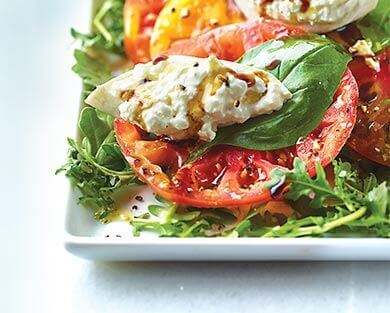 A plate of Heirloom Tomato Salad with Burrata