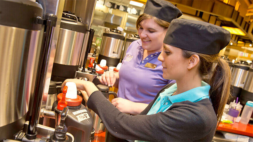 Wegmans employees making coffee