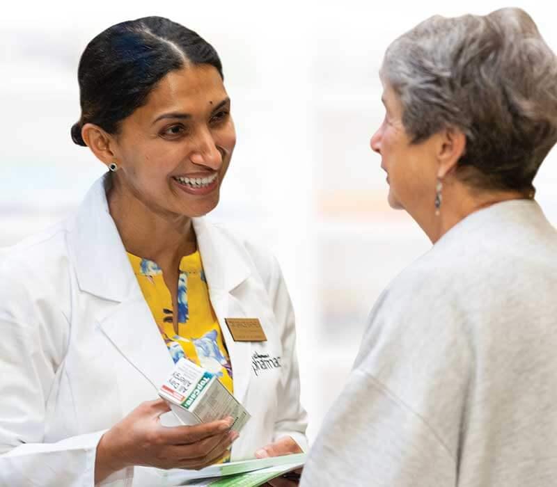 wegmans pharmacist with customer