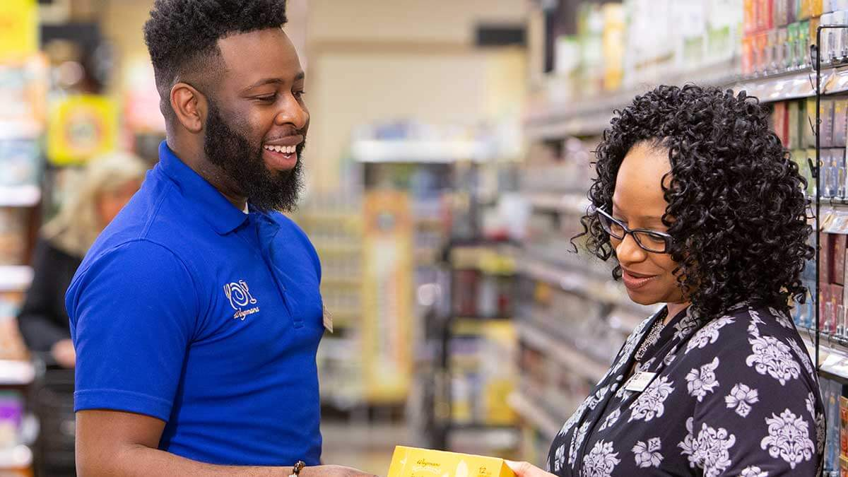 Employee and customer talking in store